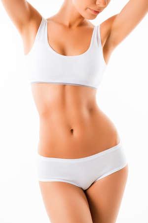 Sluit omhoog van mooi gezond geschikt slank vrouwelijk lichaam