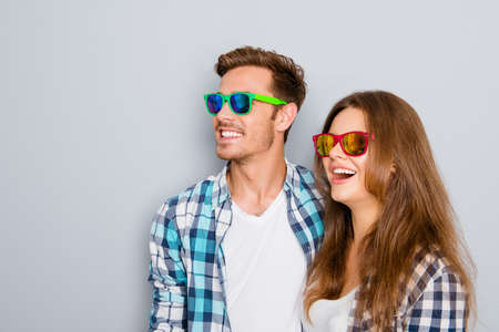Portrait of excited young cheerful man and woman in spectacles