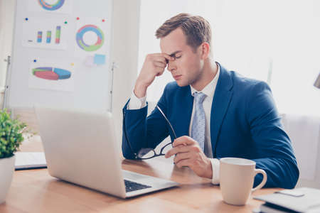 ponder: Tired ponder businessman thinking about way to complete task Stock Photo