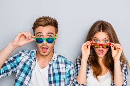Wow! Surprised man and woman in glasses with open mouth Stock Photo - 61914582
