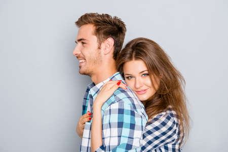 Portrait of beautiful young girl huging her handsome boyfriend Stock Photo