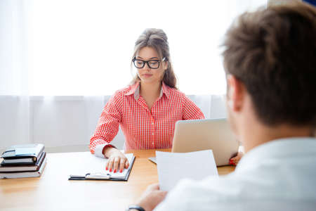 new contract: Man and woman working at office with laptop and new contract