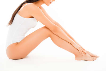 smooth legs: Close up photo of fit slim woman touching her smooth legs