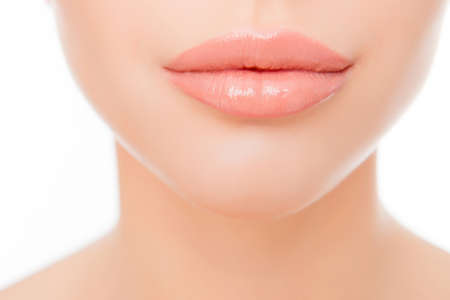 augmentation: Close up photo of full womans lips after augmentation