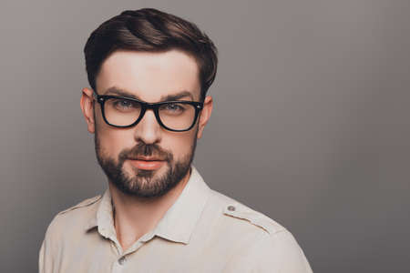 Portrait of smart young handsome bearded man in glasses 版權商用圖片