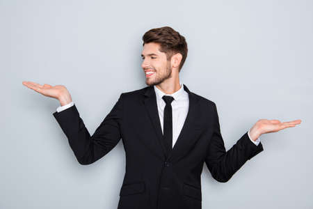 Young happy businessman gesturing with hands and showing balance