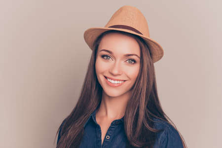 Portrait of happy cute girl in hat with beaming smile