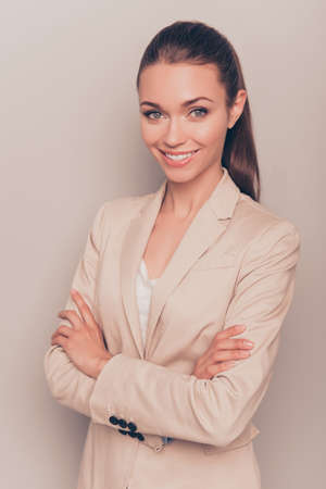beaming: Portrait of  successful businesswoman with beaming smile and  crossed hands