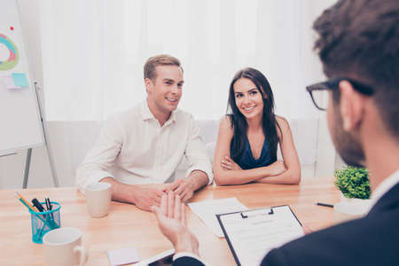 Real estate agent working with couple of customers in the office Stok Fotoğraf