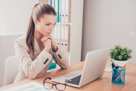 Portrait of ponder woman with laptop thinking about problem on work