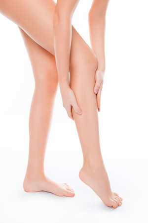 smooth legs: Close up of woman applying cream on her smooth legs Stock Photo