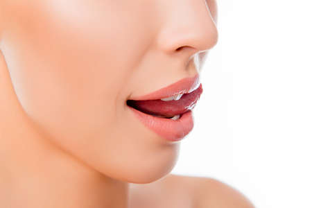 Close up of young woman licking her beautiful lips Stock Photo