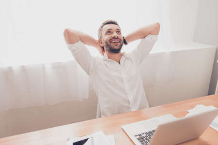 work worker: Happy bearded worker having break and resting after work