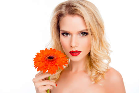 maquillage: Portrait of beautiful smiling young woman with orange gerbera Stock Photo