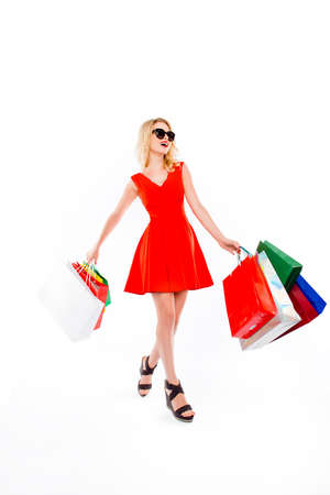 Happy woman with paperbags after shopping on white background Stock Photo