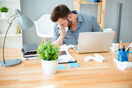 rheum: Sick businessman with temperature  working in office