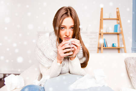 rheum: Sick woman with rheum holding a cup of tea on christmas Stock Photo