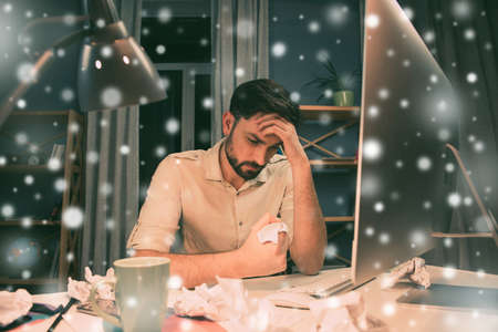 minded: Serious minded man thinking about way to solve his problems on new year eve Stock Photo