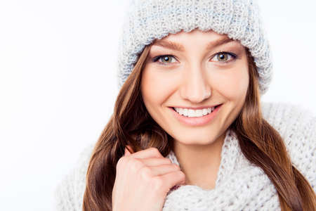 Portrait cheerful woman clothing in warm hat and scarf, close up photo