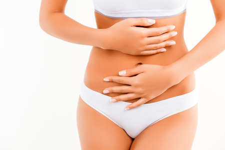 constipation symptom: Woman suffering from stomach pain isolated on white background