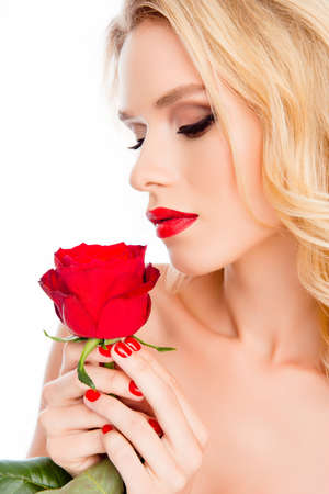 beautiful rose: Beautiful blonde woman with stylish makeup holding red rose