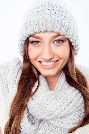 Cheerful woman clothing in warm hat and scarf, close up photo