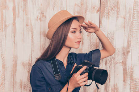 cadre: Young pretty woman with camera looking for new cadre