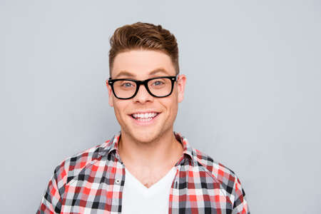 beaming: Portrait of handsome young man in glasses with beaming smile