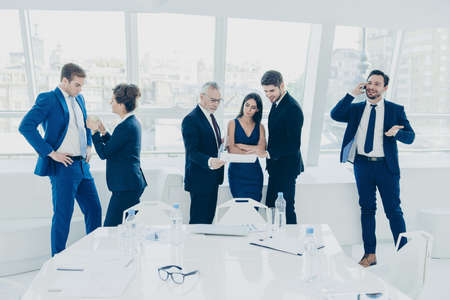 timeout: Time-out. Successful business people having rest after meeting Stock Photo