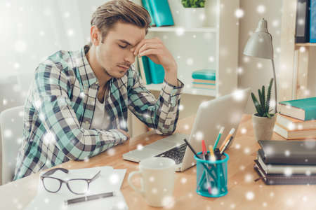 overworked: Overworked sick man in bad mood on snowy winter background