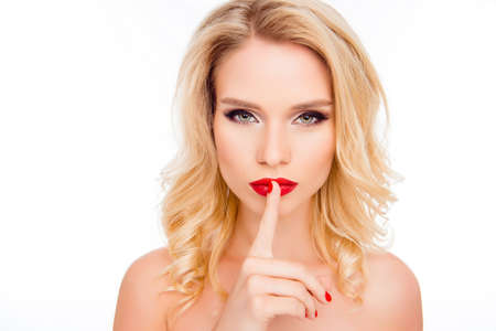 shh: Shh! Beautiful glamour blonde holding finger on lips