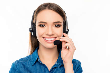 caller: Beautiful consultant of call center in headphones on white background Stock Photo