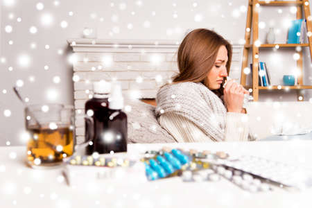 rheum: Sick woman with medicament having flu on the background of snowfall