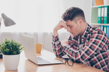 overworked: Overworked minded man having headache after working day