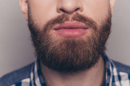 portrait of stylish young man with heavy beard