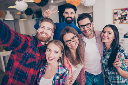 teambuilding: Its party time! six young carefree  attractive happy friends  gesturing v-sign while making selfie Stock Photo