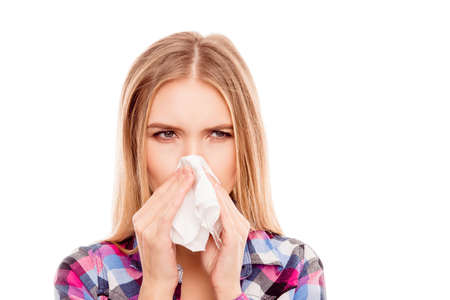 Young sick woman having allergy and sneezing in tissue Stok Fotoğraf