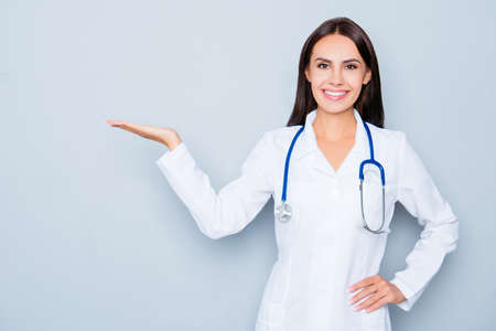 Young happy doctor making presentation of new option