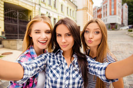 Selfie of three beautiful girlfriends pouting and winking Stock Photo