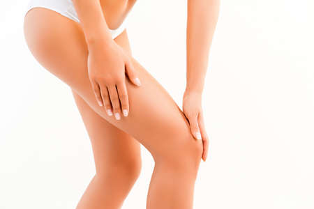 Close up of healthy fit woman doing massage for her knee