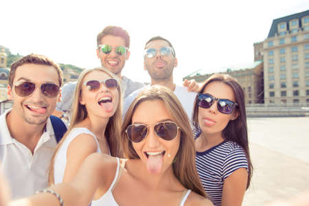 tongue out: on weekend boyfriends and  girlfriends   make selfie photo and showing  tongue out at camera