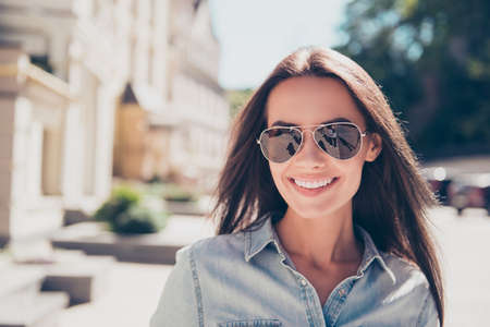 Portrait of pretty brunette with beaming smile wearing glasses