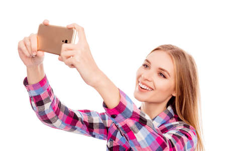 Happy smiling woman taking selfie photo on smartphone