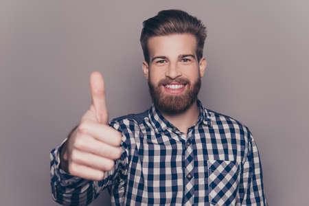 ハンサム生やした笑みを浮かべて親指を表示 写真素材
