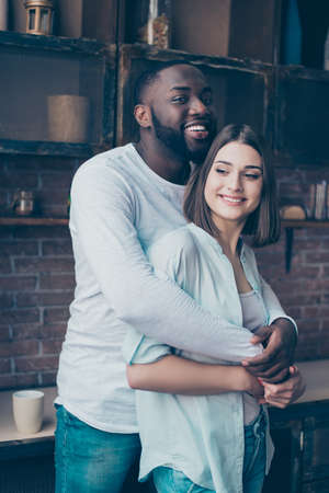 gir: Handsome afro american guy standing together with his  beautiful caucasian gir