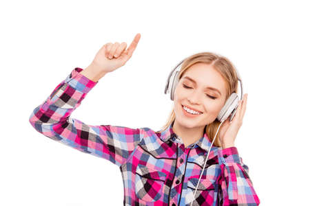 Happy music lover listening music in headphones and dancing Imagens