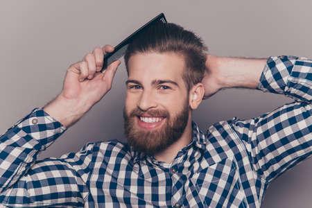 Portrait of cheerful smiling man brushing his hair Stock Photo
