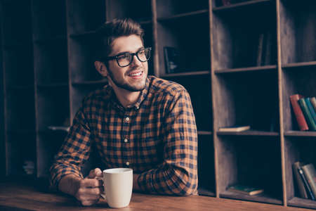Portrait of handsome manager having break and dreaming with cup of coffee 版權商用圖片 - 72079575
