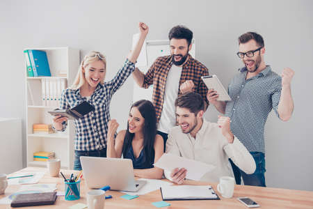 triumphing: Yes! Businesspeople triumphing because of the financial growth of company