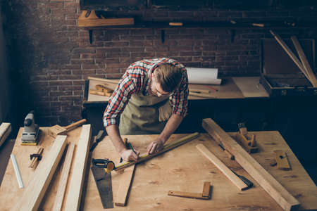 handsome joiner work in carpentry.  He is successful entrepreneur at his workplace Stock Photo